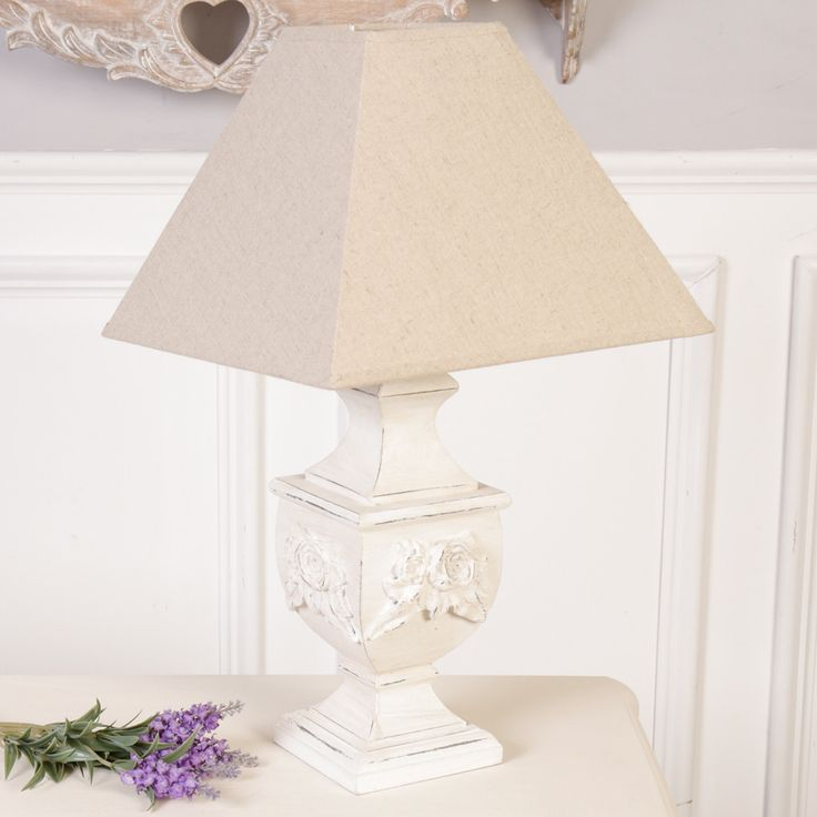 This lamp has a carved wooden base featuring traditional antique design with ornate rose detailing finished with a distressed edging giving this lamp an