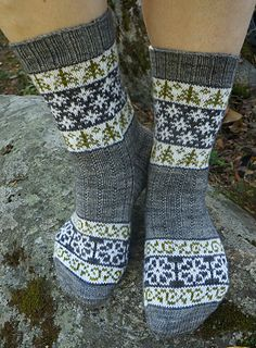 Sydämeni laulu (Song of My Heart) socks were originally designed for a sock design contest that was launched to celebrate the 100 years of independency in Finland in 2017. The stranded patterns feature Finnish nature and four seasons.  free knit pattern in Finnish and English