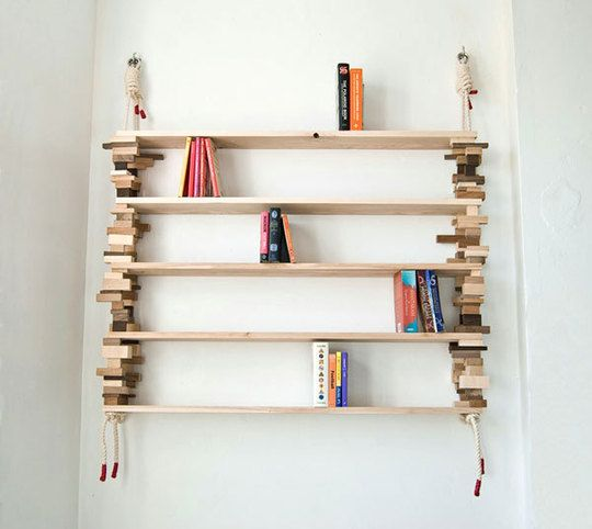 Made from salvaged blocks of wood and cotton sailing rope, the hanging Block Shelf is ideal for small spaces.
