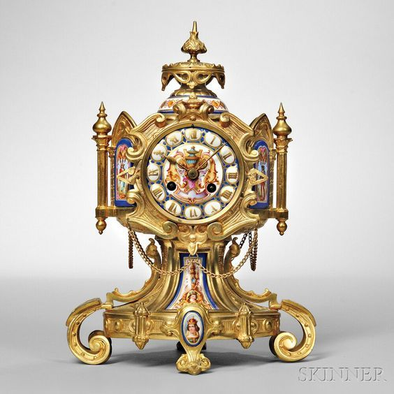 Renaissance Revival Mantel Clock, France, c. 1880, ornate gilt-brass case, hexagonal midsection with porcelain Roman numeral dial and inset panels, all on scroll feet, eight-day time and strike movement regulated by a pendulum, ht. 12 in.| Skinner Auctioneers