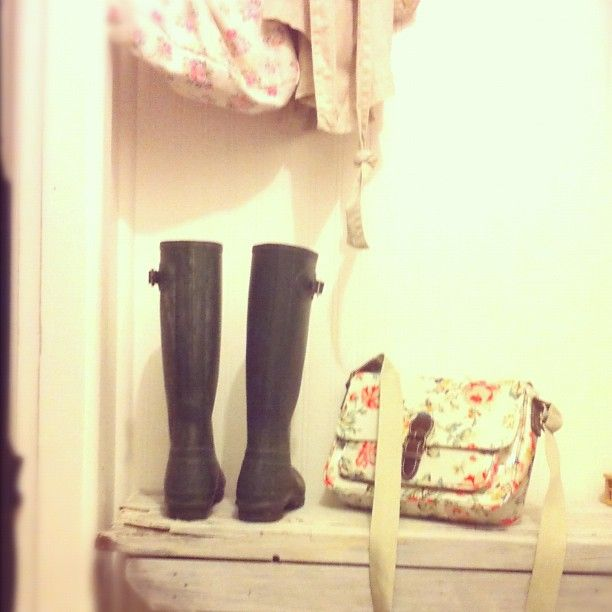 in the coastal white wash hallway with rose vintage satchel & Hunter boots