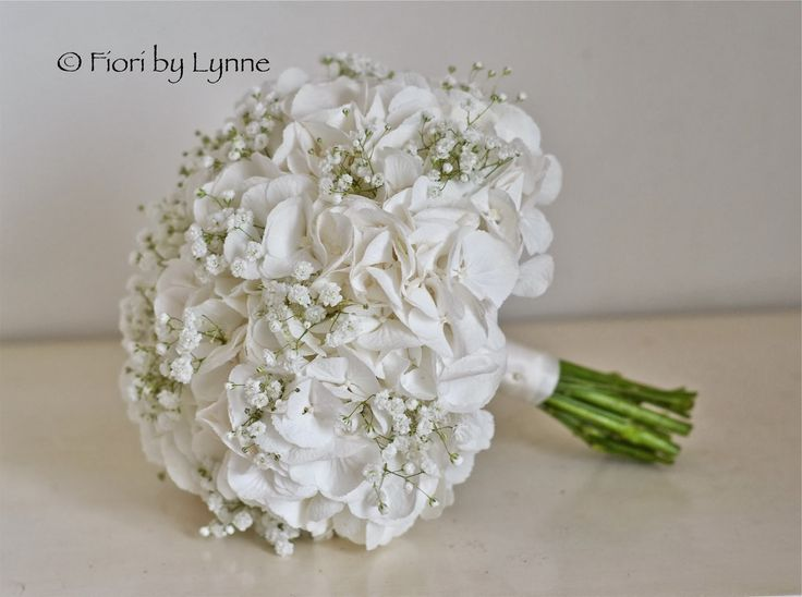 White hydrangea and gypsophila bouquet in pure and simple all whites.