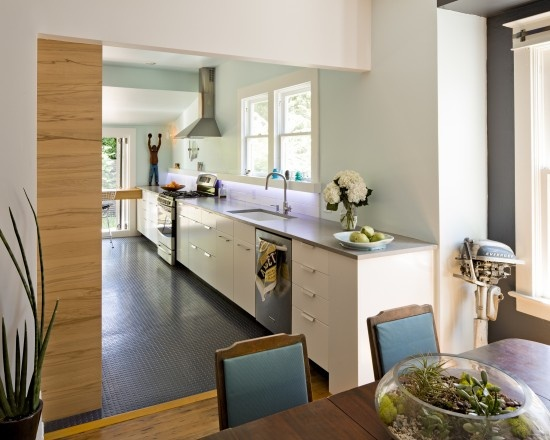 I have to admit I love that rubber flooring for the kitchen.  Soft, practical, cheap . . . .