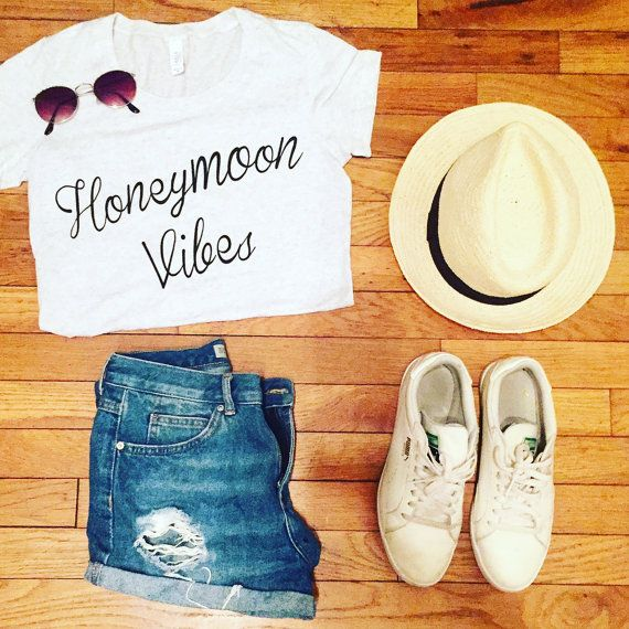 Because honeymoon vibes are the best kind of vibes! Buy it for yourself, or for a friend!   Shirts are insanely soft and cozy, but they do run small. So SIZE UP.  They are cotton/rayon/poly blend.  *NOT a crop top, just folded over for photo purposes.