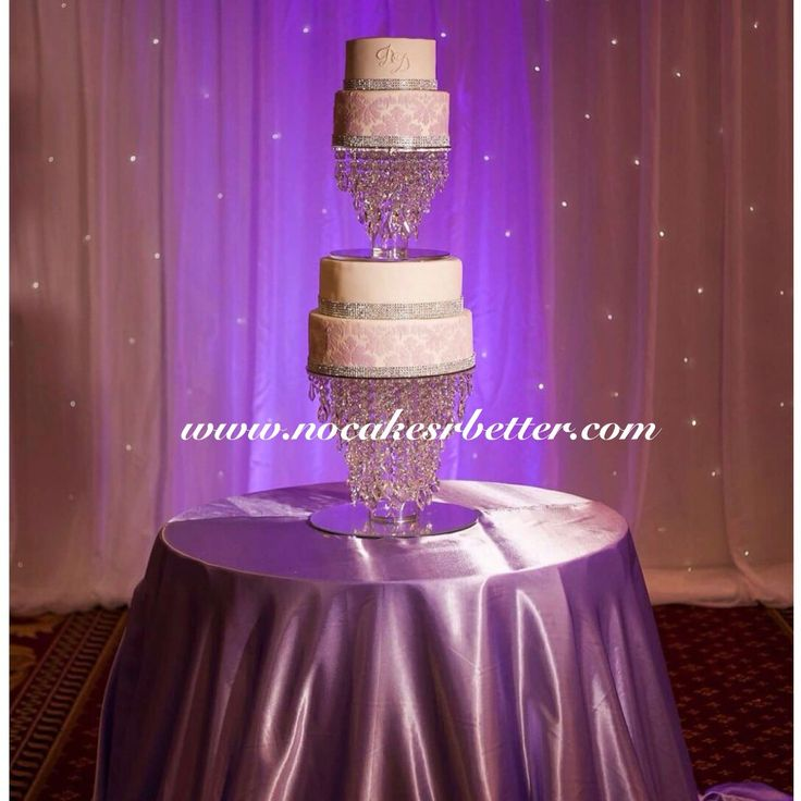 Stunning lilac damask wedding cake with swaroski crystal chandelier cake stand