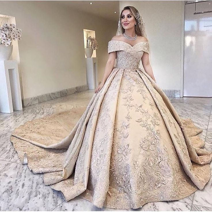 This off the shoulder bridal gown has ornate embellishments over the entire garment.  We make custom #weddingdresses like this for brides all over the globe.  Our brides can also request us to make a #replica of any couture designer gown if the original is out of their price range.  pricing and more details can be obtained when you visit our main website. www.dariuscordell.com