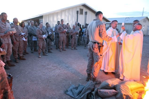 Service members attend Easter Vigil Mass conducted by Archbishop Timothy P. Broglio