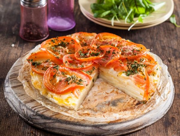Dauphinoise potato and tomato bake • This creamy, garlicky bake makes a great side dish for a roast, or even a standalone vegetarian meal.