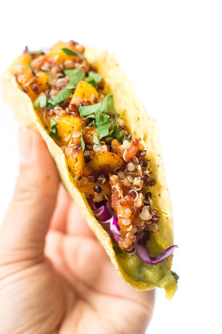 A simple recipe for quinoa tacos that is made with a spicy mango-lime quinoa filling, creamy guacamole spread and crunchy red cabbage to finish.