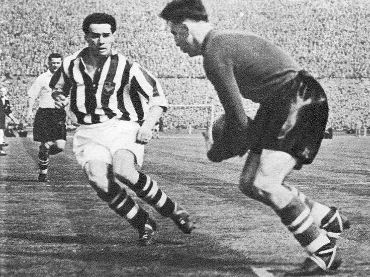 1st May 1953. West Bromwich Albion centre forward Ronnie Allen challenging Preston North End goalkeeper George Thompson in the FA Cup Final, at Wembley.