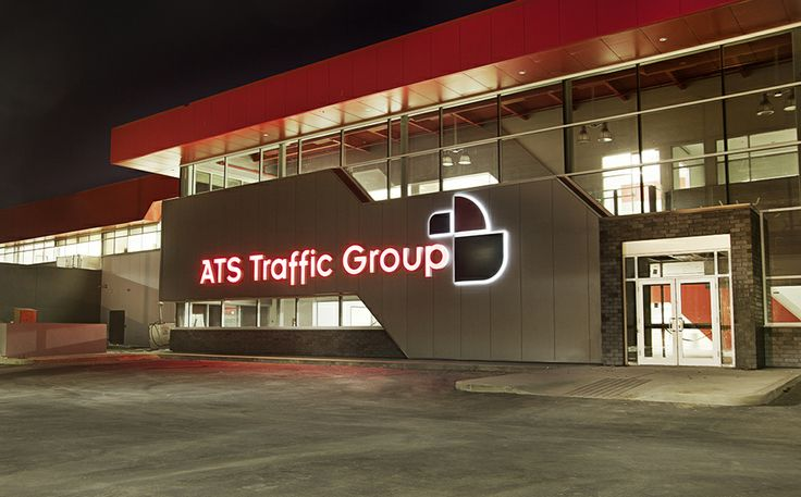 ATS Traffic Group in Edmonton, Alberta. Timeless design featuring Let-R-Edge letters with a Halo-Lit lighting effect.