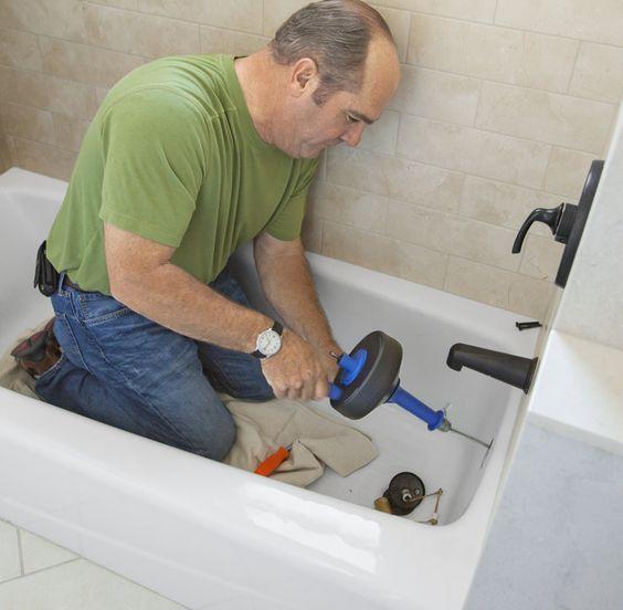 Richard Trethewey advises using a plumbing snake to remove hair clogs from bathtub drains.