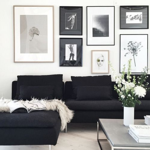 black chaise lounge grey stone coffee table and a wall of frames