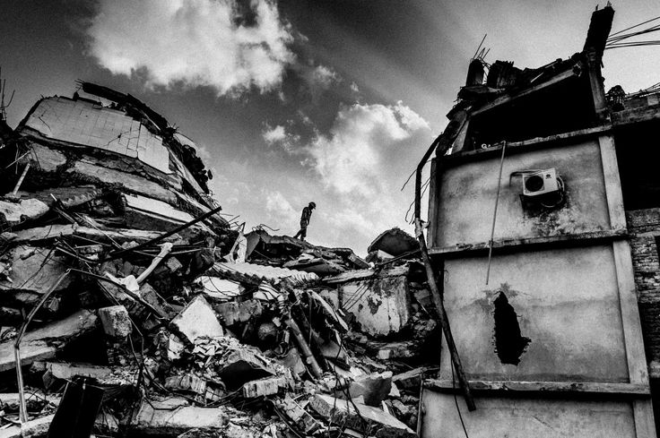 2014, Spot News, 3rd prize stories, Rahul Talukder, Bangladesh COLLAPSE OF RANA PLAZA A rescue worker inspects the site before a rescue operation with heavy machinery begins.