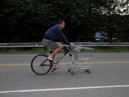Combine a derelict shopping cart with a bicycle for a ride with ample cargo capacity. This is a nice way to save a shopping cart and a bike that might otherwise end up in a landfill. It is quite the head turner but not a good corner turner.    Any mention of this project must provide a link to www.zieak.com with credit to Ryan McFarland.