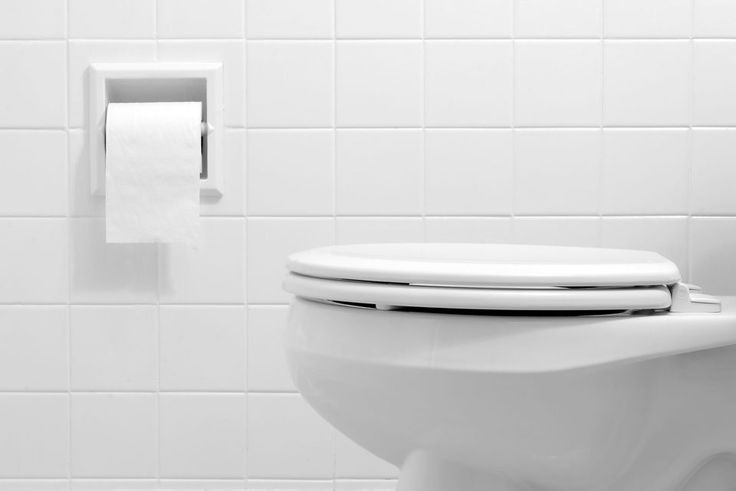 Clean, white bathroom toilet with the lid closed