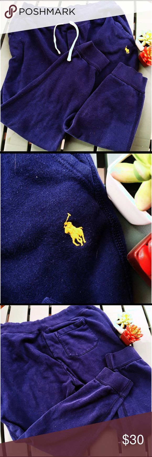 Polo Ralph Lauren Sweatpants Polo Ralph Lauren Men's Sweatpants. Color is navy blue with yellow RL emblem embroidered. Has pockets in the front, as well as one pocket in the back. Good used condition, however they are a little linty. Please note that this item is used and may show signs of previous use/wash. Polo by Ralph Lauren Pants Sweatpants & Joggers