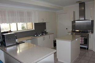 Custom designed kitchen - laminate top and vinyl wrap doors