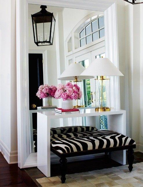 Leaner mirror behind table