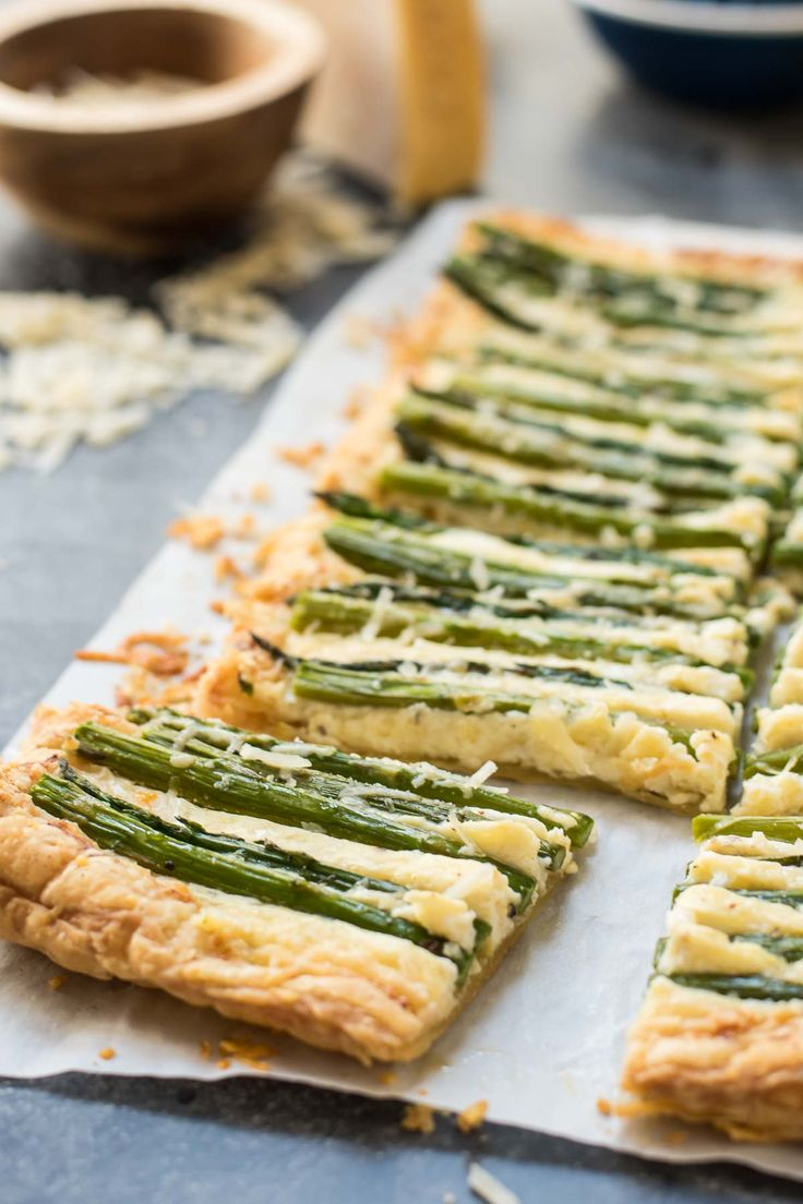 This Parmesan Asparagus Tart has a puff pastry crust with a delicious lemon, ricotta, and Parmesan filling. It's a perfect brunch appetizer!