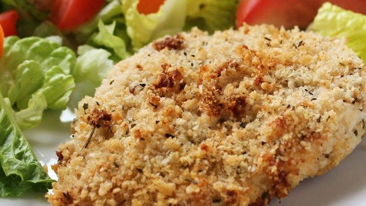 An easy recipe for chicken that's crispy on the outside, moist and juicy inside. Chicken breasts are coated in mayonnaise and seasoned bread crumbs and baked.