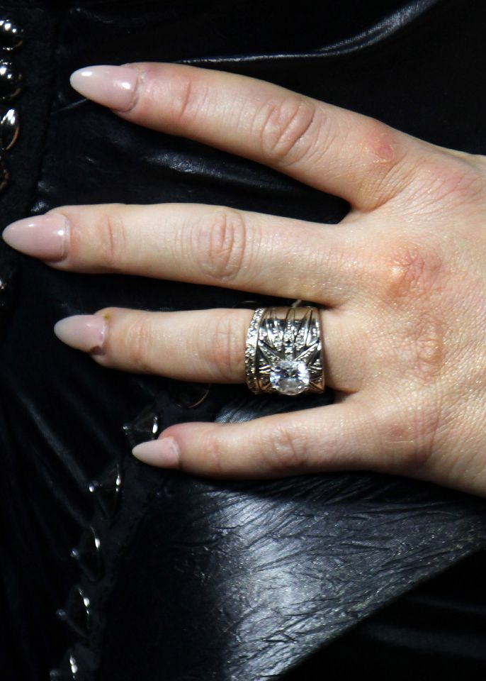 FERGIE | Husband JOSH DUHAMEL got the singer an H. Stern four-carat brilliant cut diamond engagement ring and a narrowed diamond band completed the set. Stunning. | Getty Images