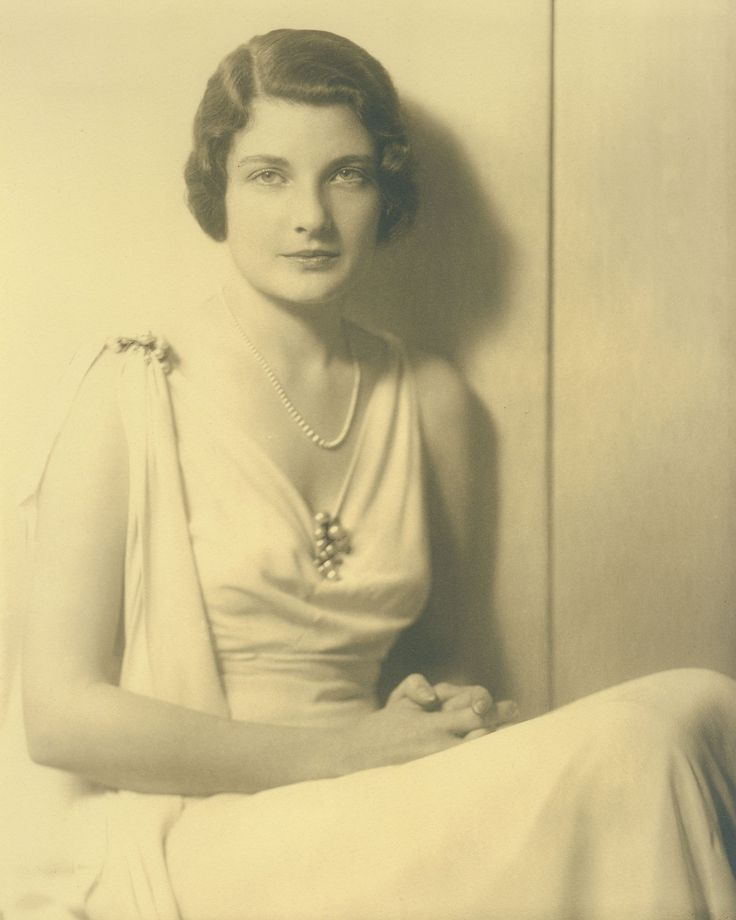 Black and white photograph of Ella Rice Hughes (Howard Hughes' first wife) wearing a light dress and pearl necklace, 1931