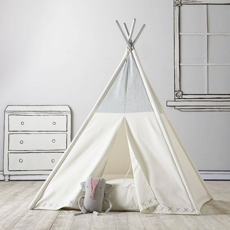 Everyone needs a little space just for themselves. This silver metallic kids teepee is the perfect home away from home while trailblazing the playroom frontier. Details, details - Nod exclusive, designed by us - Features metallic coated top panels with embroidered metallic X's along the bottom hem - Metallic silver painted poles - Tips of tent poles have a naturally weathered look that does not compromise the structural integrity of the product - 11 ties secure the front opening…