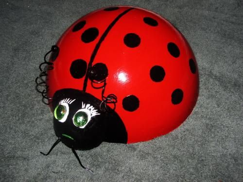 Lady Bug Bowling Ball For My Garden  (cut open an old beach ball to use for shape and fill with concrete)