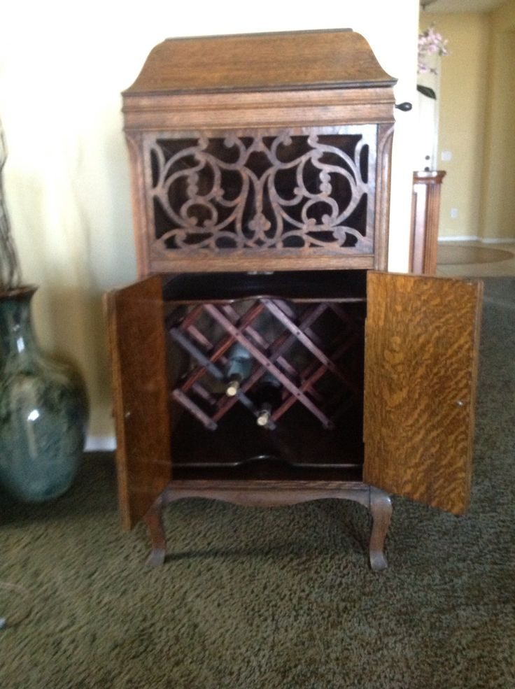 Working talking machine repurposed into a wine rack