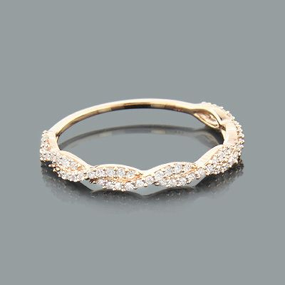 Wedding band--This Thin Stackable Designer Diamond Ring in 14K gold showcases 0.28 carats of sparkling round diamonds.