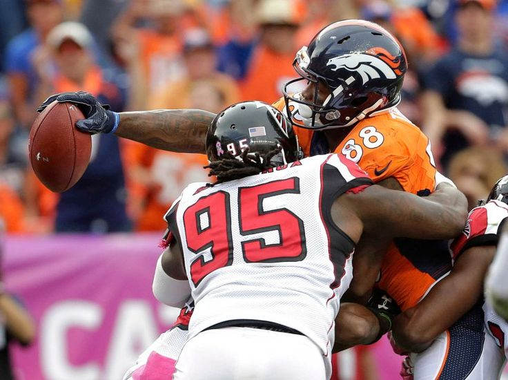 Falcons vs. Broncos:   October 9, 2016  -  23-16, Falcons.      Denver Broncos wide receiver Demaryius Thomas (88) reaches across the goal line for a touchdown as Atlanta Falcons nose tackle Jonathan Babineaux (95) defends during the second half of an NFL football game, Sunday, Oct. 9, 2016, in Denver.