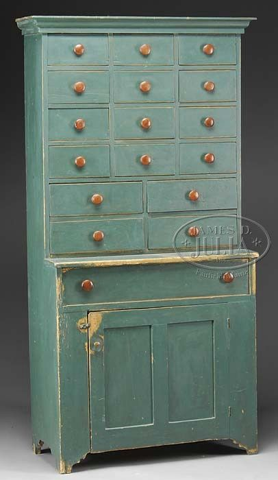 19th c. painted step back cupboard with arrangement of small drawers in upper case. Jamesdjulia.com