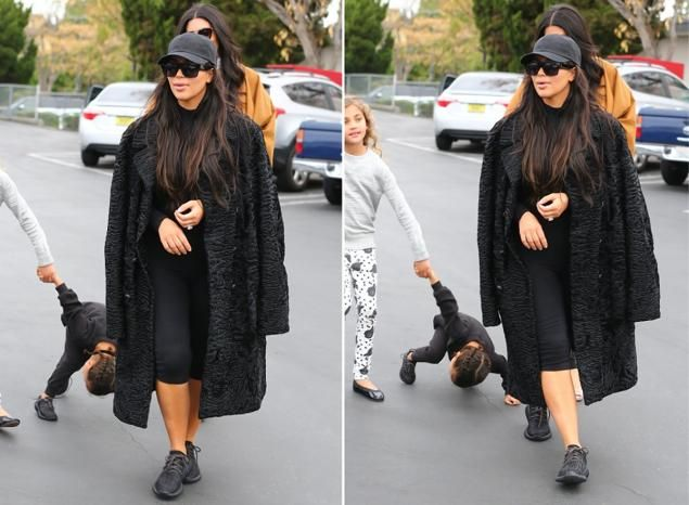 show images of kim kardashian being a poor mother | Sources tell RCV that Kim is upset that people think she would rather ...
