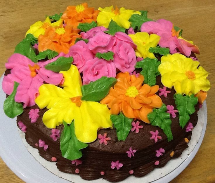 Vanilla cake with Zinnias, roses, and hibiscus flowers