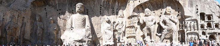 Longmen Grottoes in Luoyang, China have some of my favorite Buddha statues.  These are the largest carvings, however there are thousands of smaller ones carved into the cliff.