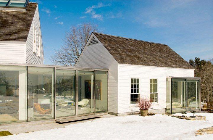 Modern glass breezeway and solarium in barn-style home; James R. Salomon photo
