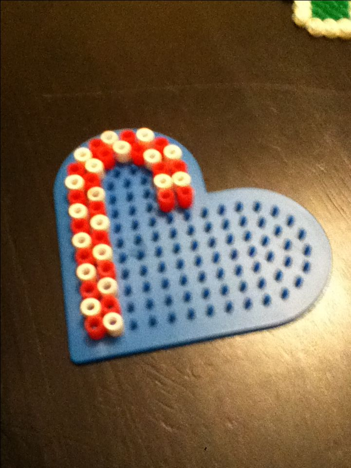 Candy Cane perler bead idea with heart pegboard. Cute ornament idea
