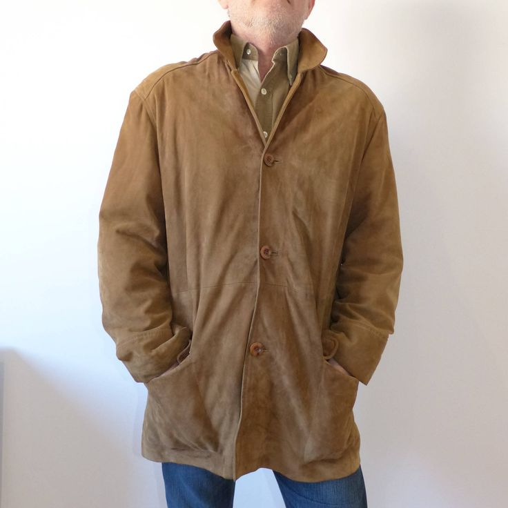 By MaletaVintageClothes on Etsy:  *** Precious 90s Vintage leather jacket for men of classic cut, with flaps and pockets. It has an opening in the back, like the classic American, but the suede from which it is made, with a lot of fall, gives it a more casual look. It adapts very well to the body, is comfortable and lightweight. It's a quite thin leather.  ***Chaqueta de piel Vintage para hombre, americana de ante marrón, chaqueta clásica abotonada con bolsillos, chaqueta hipster cómoda…