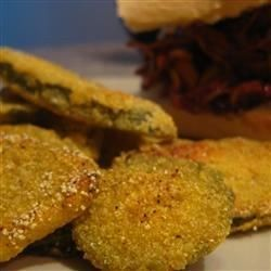 Dill pickle slices become crispy, golden appetizers when marinated in buttermilk, dressed with a corn meal/flour coating, then deep fried. Old Bay and Cajun seasonings add a kick to their crunch and a buttermilk-ranch dipping sauce.