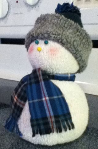 sock snow people, crafts, seasonal holiday decor, This scarf is from my old pj s The hat is also from the toe of a sock I used the pj s to make the tassel also