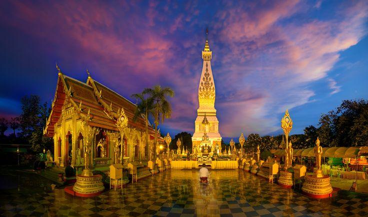 Buddhist worship for pagoda in twi - Buddhist worship for pagoda phra thatphanom in twilight at Nakhon Phanom Thailand