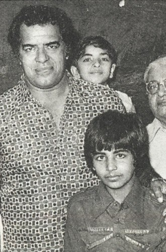 Can you identify this father and son duo?   Hint: The father was a renowned wrestler in his time.