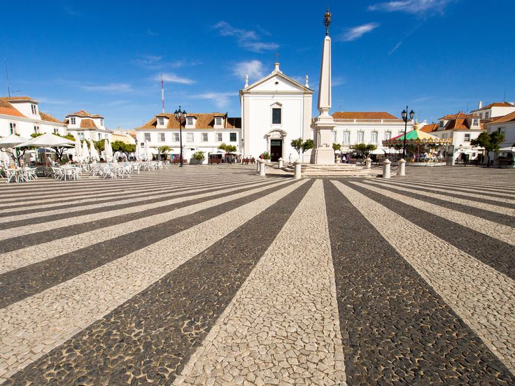 https://flic.kr/p/Ga4QxU | Marques de Pombal - Vila Real De Santo Antonio, Algarve Portugal | The former praca Real (Royal Square), now called Marques de Pombal Square, was a civic and commercial center during the Age of Enlightenment. It was delimited by the Council House and Jail (to the east), the Guard Corps (to the south) and the Church (to the North). The Square has the shape of an actual square, in which the radial has contrasting lines of the obelisk, defining it centrality.