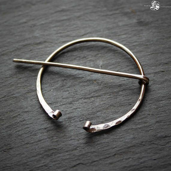 A delicate version of my classic pennanular brooch, this time with rustic curled ends inspired by Viking age brooch design. The curled ends keep the pin securely on the base and add dimensional detail. This is a light weight pin, perfect for lace, sport or dk weight knitting.  The pin