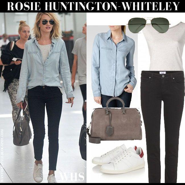 Rosie Huntington-Whiteley in light blue denim shirt, black skinny jeans, white sneakers, aviator sunglasses and suede duffel