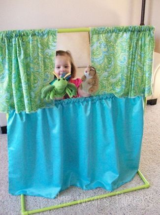 Puppet Theater  with PVC. Brilliant, because it would be easy to take apart and built up again. Great for storing it when not in use.