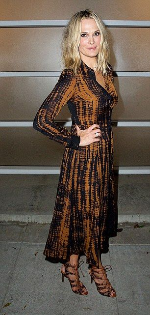 Pretty print: Molly Simms, 43 donned a tie-dye dress in subtle tones