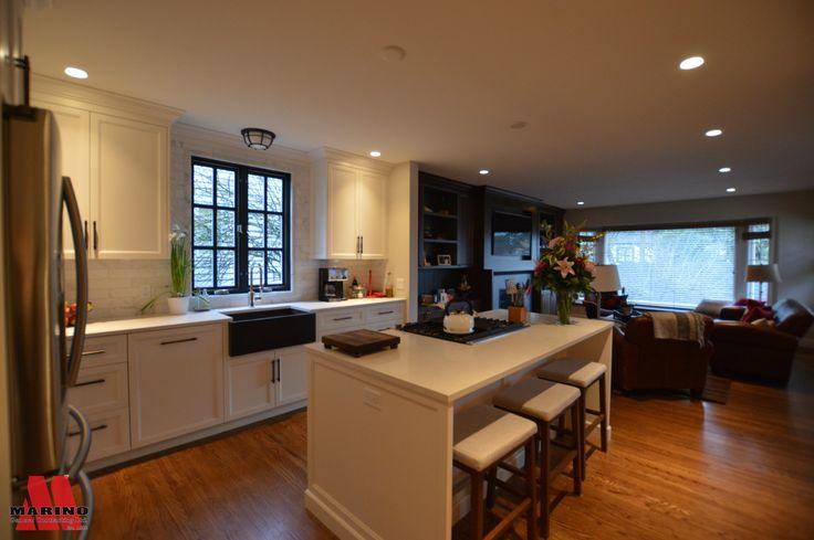 Black Farmhouse sink, open concept kitchen, white cabinetry