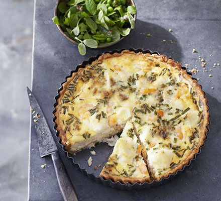 Fish pie tart with minted pea salad. This creamy tart is full of smoky fish and sweet prawns, but less heavy than the usual mash-topped pie